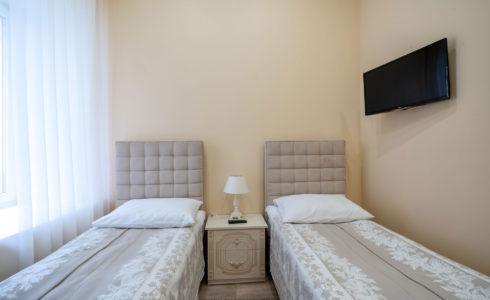 Двухместный стандарт с двумя раздельными кроватями и ванной комнатой